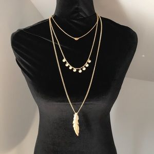 Jewelry - Layered gold toned necklace with feather